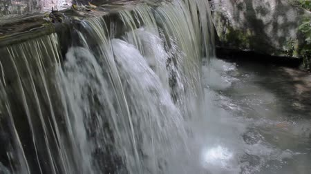 kurtyna : Waterfall Side View (HD). Waterfall with ambient audio from a man made dam on a river stream. Wideo