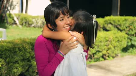 bonding : Girl Hugging Mother Two Angles (HD). Hispanic four year old girl hugging mother after approaching her fast. Two angle takes provided, side and three quarters.