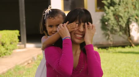 bonding : Guess Who Mom and Daughter (HD). Guess Who? game between mother and daughter. Hispanic ethnicity. Stock Footage