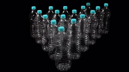 empilhamento : Plastic Bottle Arrangement With Alpha (HD). Green Screen shot transparent plastic bottles, made out of hi res still images, carefully masked frame by frame with perfect green and shadow removal. Stock Footage