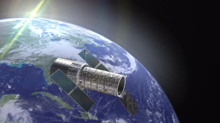 solar : Hubble telescope on a space environment with earth as background with camera motion. Hubble Space Telescope Animation (HD). Elements of this image furnished by NASA.