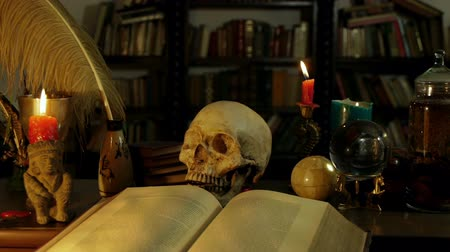 czarodziej : Wizards Study Desk (HD). Wizards study setup desk with a skull, candles, crystal ball, books, chalice, and other occult paraphernalia. Skull is resin replica not real.