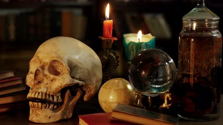 czarodziej : Occult Magic Desk (HD). Occult study setup desk with a skull, candles, crystal ball, books, and other occult paraphernalia. Skull is resin replica not real