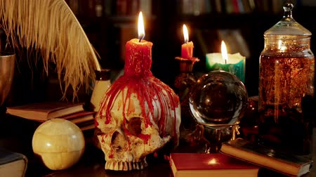 philosopher : Melted Skull Candle Magic Artifacts (HD). Occult study setup desk with a skull chandelier