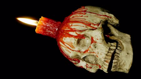 dia das bruxas : Candle Skull Loop Alpha (HD). Red candle melted on top of a human skull replica. Vídeos