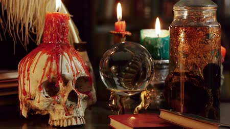 philosopher : Melted Skull Candle Tilt Down (HD). Tilt Down shot of Wizards study setup desk with a skull chandelier