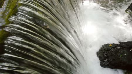 diretamente : Water Drop From Above (HD). Water drop seen from above from a man made dam. Ambient audio included. Stock Footage
