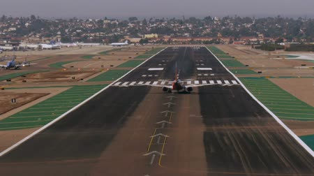 letadlo : Jet Liner Takes Off at San Diego Airport Runway All logos Removed.