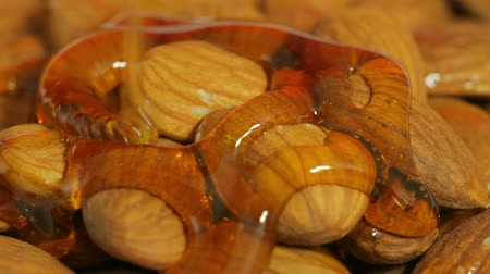 orzechy : Almonds With Honey Dripped Macro