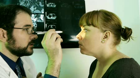 vital signs : Doctor Checking Eyes (HD) routine eye and vision checkup on a woman. Take changes into eyes view. Stock Footage