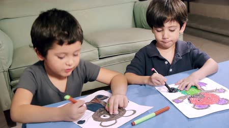 meksika : Young Boys Coloring Drawings (HD). 2 brothers of Hispanic origin; coloring a bear drawing.  Drawings all released.