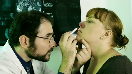 egzamin : Doctor Checking Nose (HD) routine nose checkup on a woman. Take changes into nose canals close up.