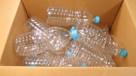бутылки : Plastic Bottles Recycled on Box Стоковые видеозаписи