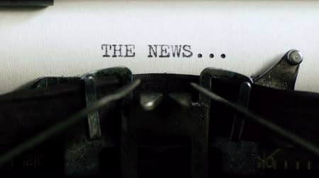 yazarak : Typing The News (HD). The News - being typed and centered on Vintage 1940s typewriter. Ambient audio Included.