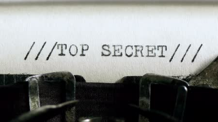 segredo : Typing TOP SECRET (HD). TOP SECRET being typed and centered on Vintage 1940s typewriter. Ambient audio Included.