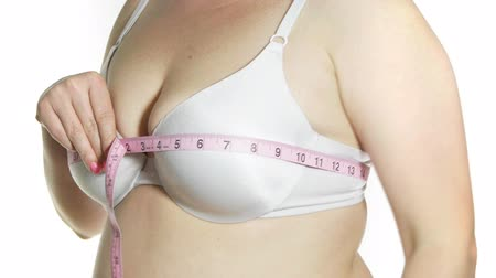 piersi : Female Measuring Measuring Bust Size 38C. Woman is overweight.