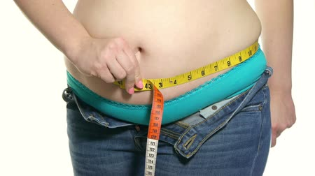 nadváha : Overweight Female Measuring Waist Color Measuring Tape. Hands Sample Belly Fat. Dostupné videozáznamy