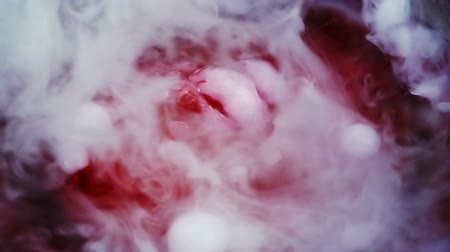 účinky : Bubbly Red Liquid With Carbon Dioxide Smoke Bubbles Slow Motion.