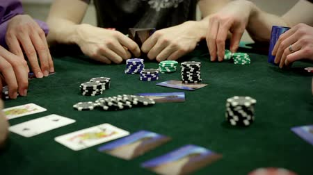 покер : A group of adults (gentlemen) play texas holdem poker