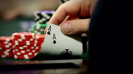 A group of adults (gentlemen) play texas holdem poker