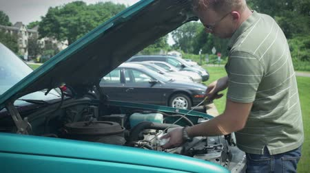 karbantartás : Checking oil under hood of car vehicle. Adding oil.