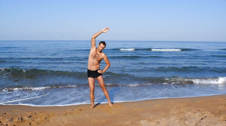 elvonult : Morning exercises on the beach Zakharo, Greece. Stock mozgókép