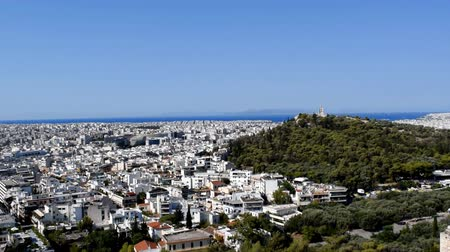 saronic : The sunny cityscape of Athens, Greece.