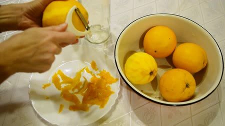 limonada : Removing the zest from the orange to make liquor.