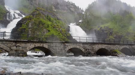 hordaland : Langfossen Waterfall is located very near the E134 highway. Norway.