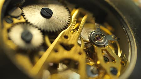 медь : Close up of an internal clock mechanism