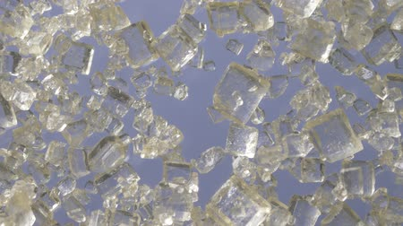 sweetener : Macro shot of moving sugar crystals in slow motion Stock Footage
