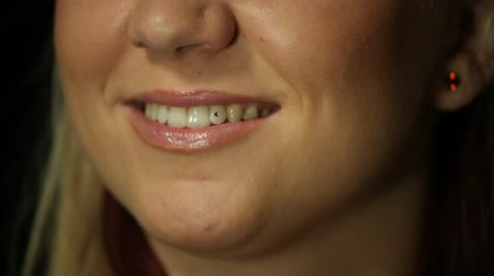 ağız : Close up of smiling girl with little diamond in tooth