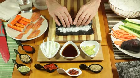 roll : Closeup of rolling Sushi roll with salmon Stock Footage