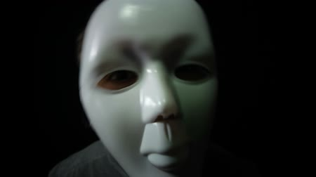 male : Spooky masked man over black background Stock Footage