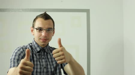 nerd : Young happy man showing thumbs up and dancing