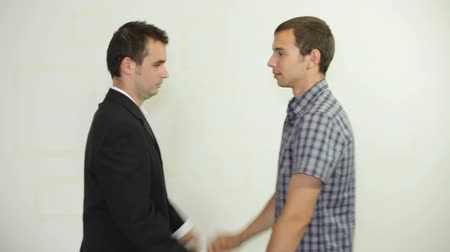 humor : Two funny businessmen handshaking and jumping