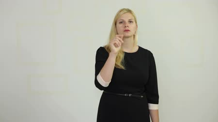 züppe : Self-confident serious businesswoman pointing and selecting Stok Video