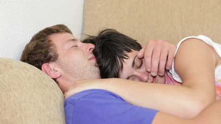 napping : Closeup of young couple sleeping on sofa