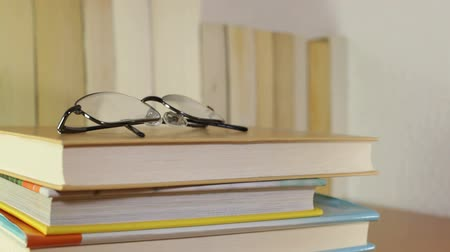 schoolbook : Books and eyeglasses in study room