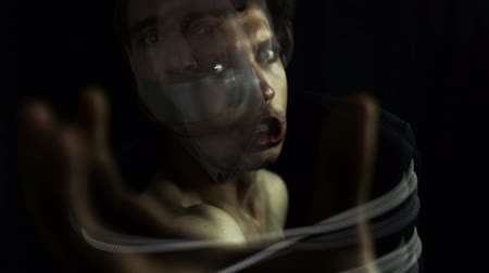sinir : Horror kidnapper and scared hostage, surreal video expression.