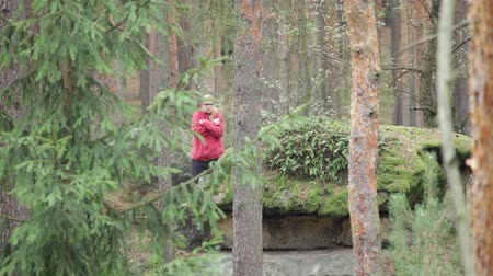 zmrazit : Unhappy lost woman shivering in cold in the forest.