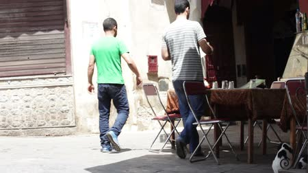 marrocos : Fes, Morocco - 18 July 2014: Local people and tourists walking in the Medina of Fes.