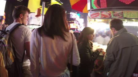 New York City, USA - 19 May 2015: Crowded streets and Times Square at night in Midtown Manhattan.