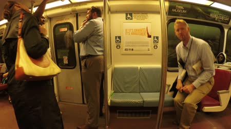 usa : Washington DC, USA - 15 May 2015: People travel in public train metro.
