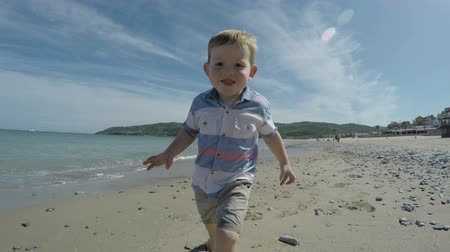 sport dzieci : Happy active child boy running on the beach and enjoying sunny day in Spain.