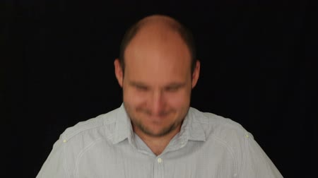 waggle : Positive man nodding his head, studio isolated on black background. Stock Footage