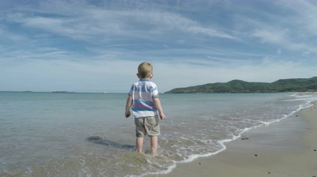 bengala : Happy active child boy enjoying sunny day on the beach in Spain. Stock Footage