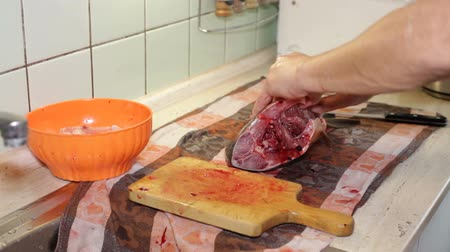 bowels : A man cutting and disemboweling a carp fish in the kitchen. The traditional Christmas fish in the Czech Republic. Stock Footage