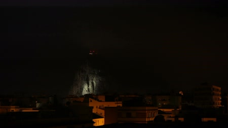 electrostatic : Lightning on the night sky above the Rock of Gibraltar and La Linea de la Concepcion in Spain.
