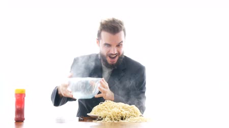 orgazm : Ecstatic mad businessman eating pasta on the table. Overeating and crazy greedy consumerism concept, studio isolated on white background. Wideo